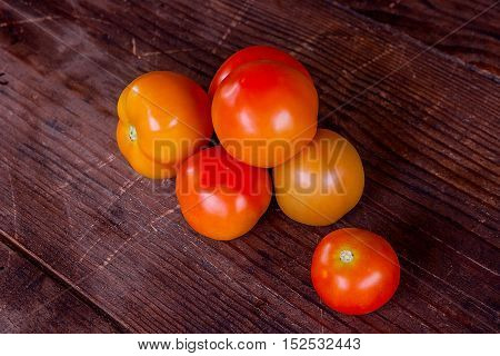 Close Up View Of Fresh, Ripe Tomatoes On Wood Background.