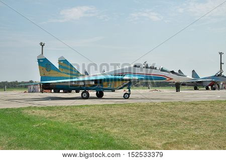 Vasilkov Ukraine - August 3 2012: Ukrainian Air Force Mig-29 fighter plane in colorful painting is taxiing to the runway for takeoff