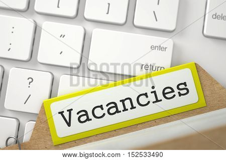 Vacancies written on Yellow Card File on Background of Modern Metallic Keyboard. Closeup View. Blurred Illustration. 3D Rendering.
