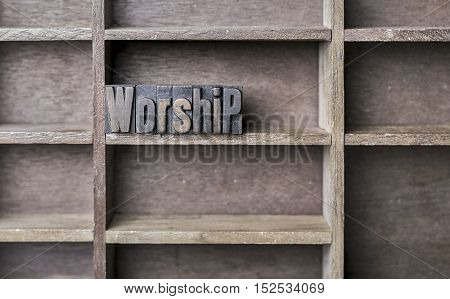 old wooden printers type forming the word worship
