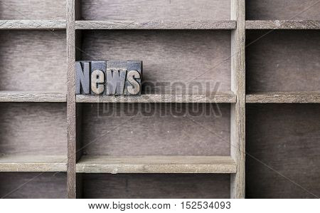 old wooden printers type forming the word News