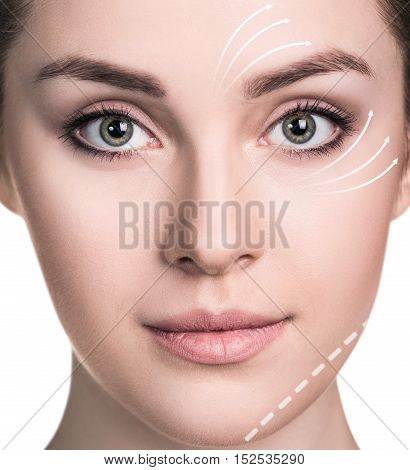 Beautiful woman face with correction lines. Isolated on white background.