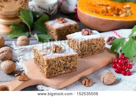 Pumpkin cake with nuts on wooden table