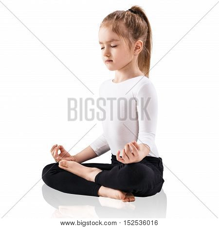 Little girl meditating in lotus position, isolated on white