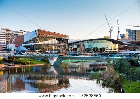 Adelaide Australia - September 11 2016: People walking through Torrens foot bridge from Adelaide Oval after game in Adelaide city centre at sunset