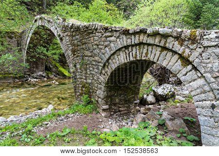 Old traditional stone bridge in Thessalia, Greece