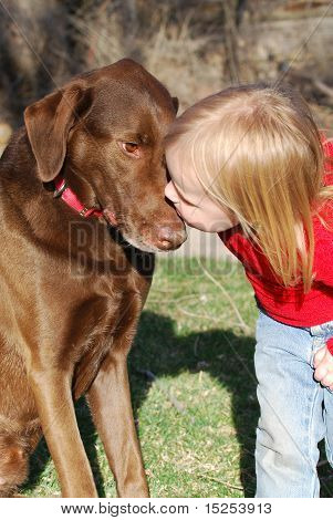 Little Girl Kissing a Dog