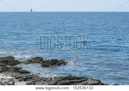 Wavy Blue Sea Rock Land and Sailor Boat Minimal