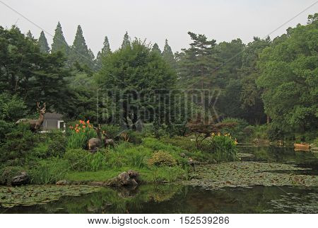 pond with interesting sculptures in park of Hangzhou China