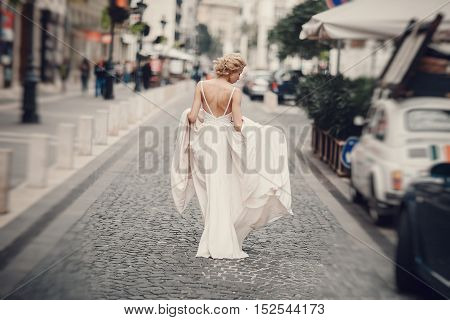 beautiful unique couple walks into your wedding day in Budapest