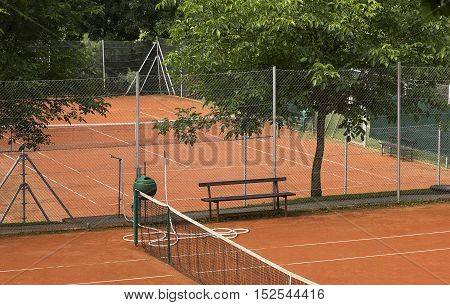 Small tennis court with an orange sand.