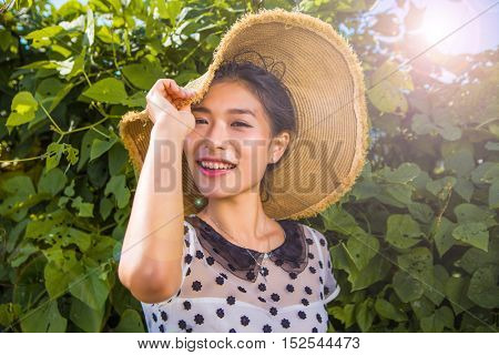 Chinese woman touching her hat