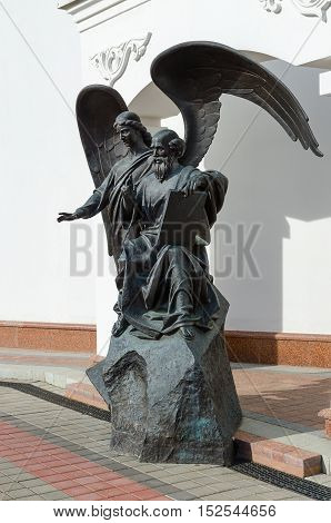 MINSK BELARUS - OCTOBER 1 2016: Sculptural composition (monument to John the Theologian) at church of St. Cyril of Turov Minsk Belarus