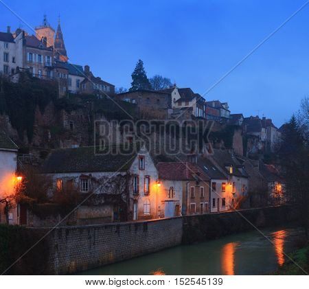 River embankment Armancon  at dusk,  Semur-en-Auxois, Burgundy, France.