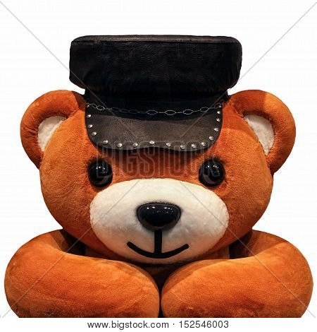 Teddy avatar toy orange leather hat autumn looking at the table
