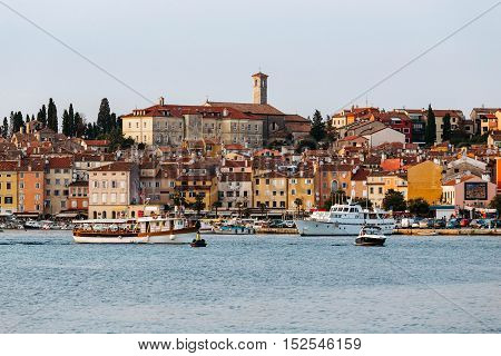 The historic part of Rovinj in the sunset. Above roofs of houses rises Monastery of St Francis.