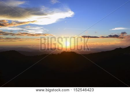 The sunset at the mountain with the twilight scene.