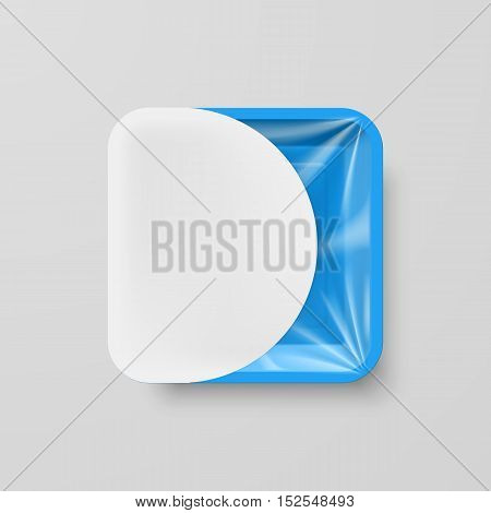 Empty Blue Plastic Food Square Container with White Label on Gray