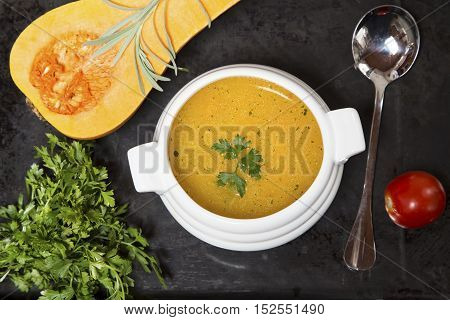 Pumpkin soup with the fresh squash parsley and tomato