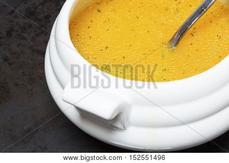 Pumpkin soup in a white porcelain bowl