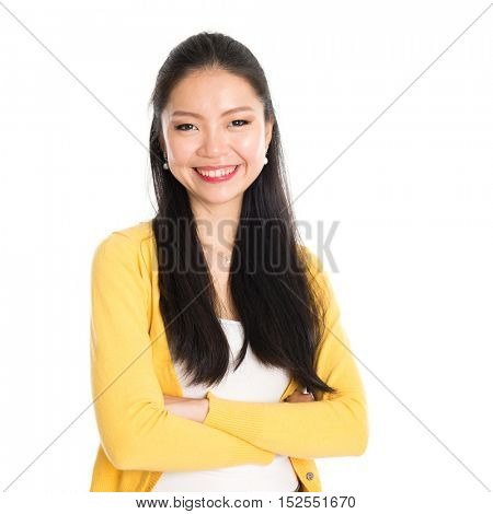 Portrait of Asian female, smiling looking at camera, standing isolated on white background.
