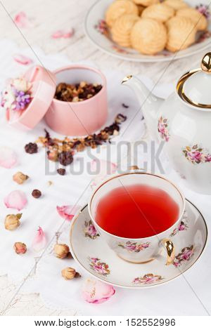 cup of red tea on white serving table