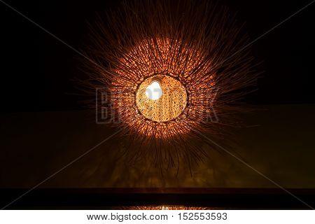 Decorative wicker lamp in dark room. Asian decor