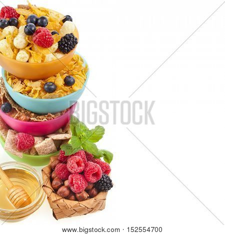 Diet weight loss breakfast concept , tower stack with fresh berries and corn flakes isolated on a white background