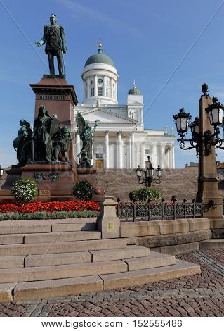 HELSINKI, FINLAND - AUGUST 21, 2016: Statue of Emperor Alexander II on Senate square against Helsinki Cathedral. The statue was built to commemorate his re-establishment of the Diet of Finland in 1863