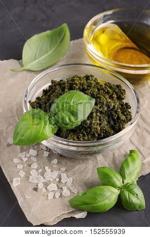Pesto And Olive Oil In Glass Bowl And Fresh Basil Leaves