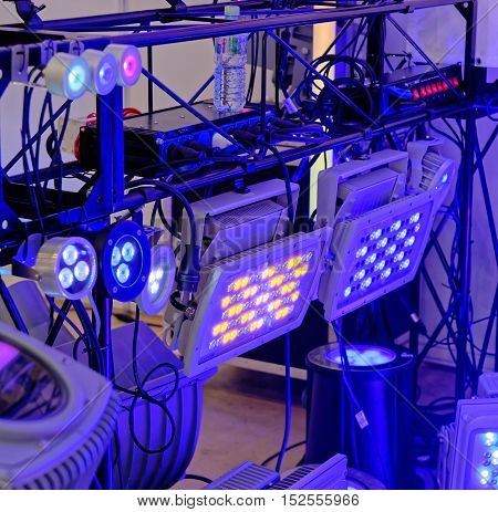 Colored Led Spotlights At The Front, Connected By Cables.