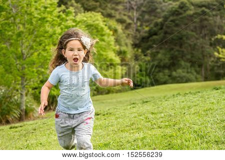 outdoor portrait of young happy child girl on natural background