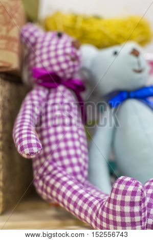 checkered background toy bear handmade on a shelf in a shop toys
