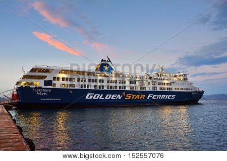 Rafina Greece - Sept 19 2016: View on the Rafina harbor and Golden Star ferries at sunset time one from a many small port in Attica