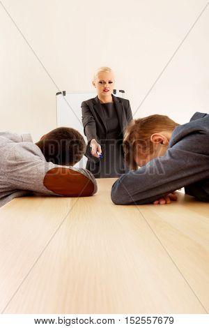 Two businessman sleeping on business presentation