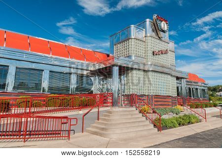 LITTLE FALLS NEW JERSEY USA - SEPTEMBER 19 2012: The iconic art deco style Park West diner a well known traditional American restaurant with its polished chrome and enamel metal exterior a piece of historic Americana