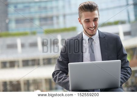 young modern businessman searching job by laptop