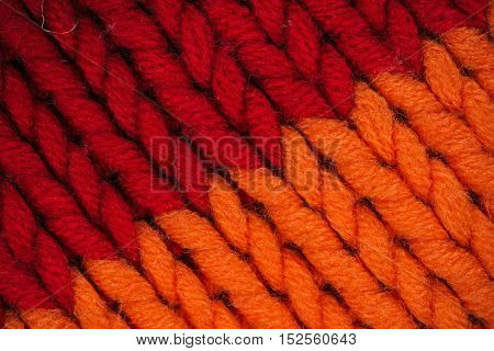 Macro flat view of knitted surface in orange and red
