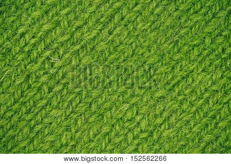 Macro flat view of knitted surface in green