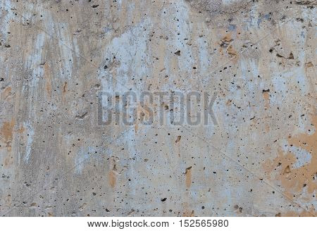 Image of a concrete wall in shades of brown and grey suitable for use as a background or texture.