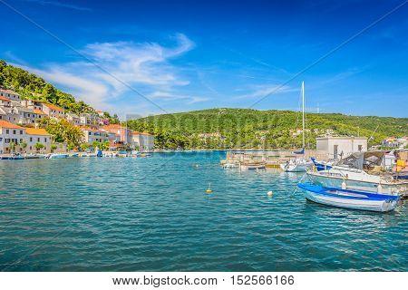 View at Island Brac seascape in small mediterranean place Pucisca, Croatia landscape.