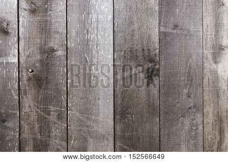 Old and weather worn brown wooden plank texture wall background