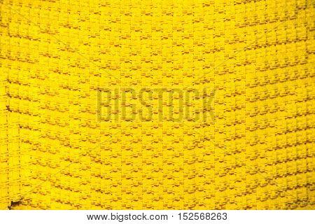 Background made of plastic yellow construction blocks
