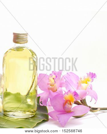 Spa Background with pink orchid and oil, towel,leaf