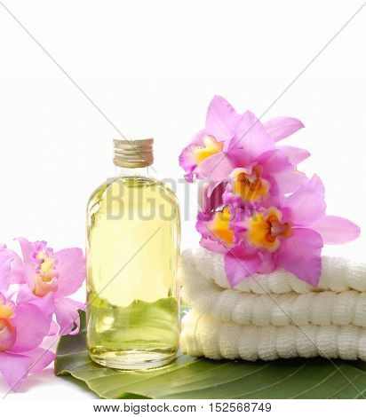 Spa Background with pink orchid on towel,leaf, bottle oil