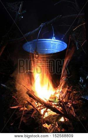 Tourist kettle on fire in darkness