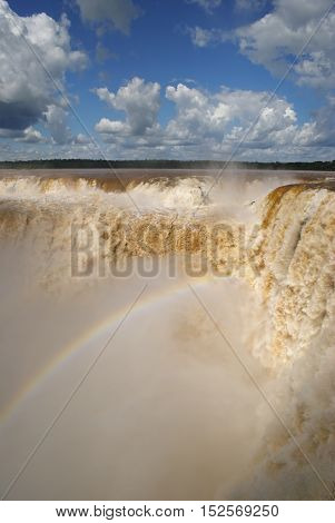 Enormous amounts of water thundering down the devil's throat at Iguazu waterfall, Argentina