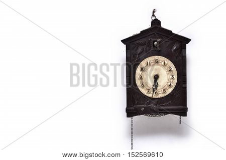 Broken cuckoo clock covered in dust and cobweb
