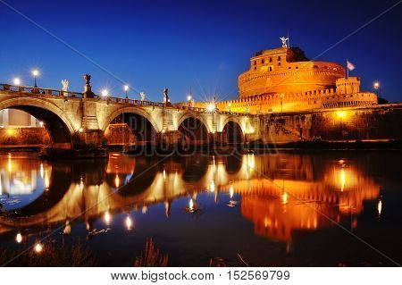 Rome Italy - scenic view of Castel Sant'Angelo (Mausoleum of Hadrian) and bridge over river Tiber at night