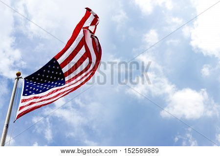American Flags commemorating a national holiday veterans day independence day Blue sky background